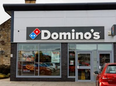 Photo of Domino's storefront.